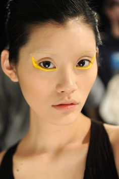 What a lovely face -- would love to know how to get rid of the yellow eyeliner