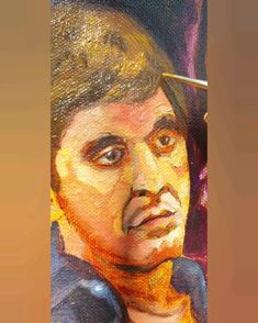 Artist Maibis Navarro paints the portrait of Al Paccino in the film Scarface