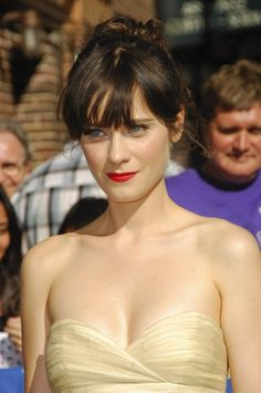 zooey deschanel. light gold dress, bright red lipstick, no jewelry and those crazy blue eyes. total hottie!!!!