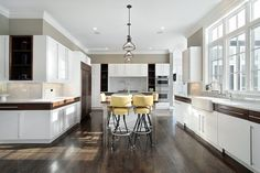 Apartment condo white kitchen meandering throughout the living space with large windows