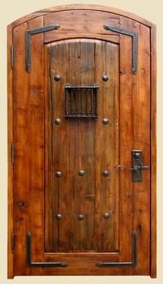Constructed with antique Mexican door, fitted with large clavos and custom-forged L straps and grillwork. Lever handled hardware with round key flap is cast bronze.  9529-04 McDougall
