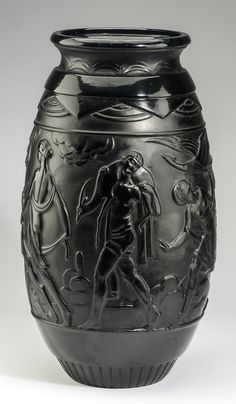 French Art Deco glass vase by Sabino, of ovoid form with black satin patina and decorated with a bas relief band of classical figures, including the goddess Diana, archers, and a hunter, the underside with engraved signature 'Sabino Paris'.