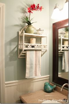 Wicker shelf accessorized.  Wall color is Quietude by SW