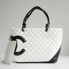 Faux Leather White Shoulder Bag Adorable *IMITATION* design. Gently used. Only signs of wear or on the bottom. Inside is spotless with a gold lining. Does not come with wristlet as seen in first photo. Comes with protective bag. Channel Bags Shoulder Bags