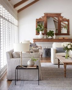 neutral living room space with wood accents