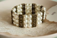 Elegant Bracelet, Stretchy Bracelet, Bronze Spacers Bracelet with Ivory Glass Pearls, Off White Beads Bracelet, Three Strand Bracelet Strand Bracelet, Beaded Bracelets, Handmade Items, Handmade Jewelry, Mom Day, Butterfly Earrings, White Beads, Stretch Bracelets, Bracelet Making