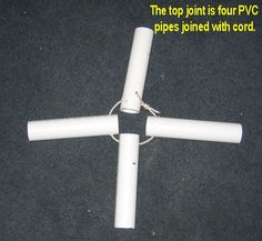 The pyramid supports insert into the PVC pipes and the bungees hook to the cord between the pipes.