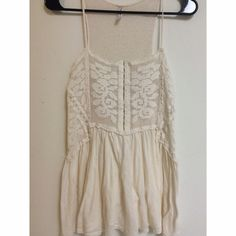 Free People Ivory Crochet Top XS This Free People Top is size XS and very soft and flowy. The top part is crochet so you can partially see through it. Only been worn a few times. Super cute and boho! Free People Tops Tank Tops