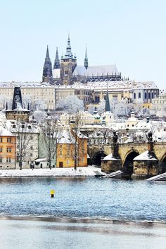 Romantic Snowy Prague gothic Castle with the Charles Bridge, Czech Republic