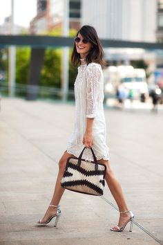 Delicate vintage white dress, ethnic inspired bag print, dazzling metallic shoes - this is a globally fashionable woman on the go!