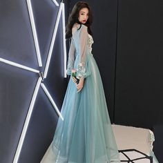 f797faab0f7 Long Sleeved Sheer Floral Prom Dress. The Dress Rail Boutique