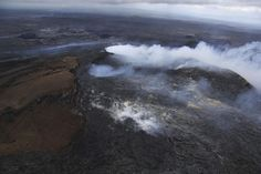 The Pu'u 'O'o crater of the Kilauea volcano partially obscured by thick fume from the June 27 lava flow near Pahoa, Hawaii., Aug. 22, 2014. (AP Photo/U.S. Geological Survey, Tim Orr)