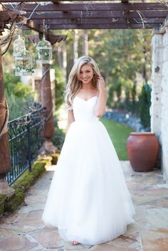 Made With Love's Jayne Wedding Dress with a lacey, beaded bodice, spaghetti straps, and a full tulle skirt