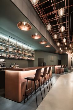 bar, lifestyle, interior design, industrial floor, cooper, rustic leather, barstools, ceiling installation, Bar Eduard's by DIA – Dittel Architekten