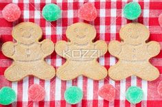 close-up image of colorful candies and gingerbread man. - Close-up image of colorful candies and gingerbread man on red checked napkin.