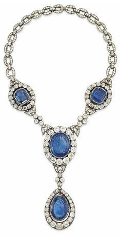 AN ANTIQUE SAPPHIRE AND DIAMOND NECKLACE.  Composed of three sapphire and diamond clusters joined by diamond collet quatrefoil accents, suspending a further sapphire and diamond drop pendant, with diamond-set back chain, mounted in silver and gold, 19th century with later alterations, 56.0cm long