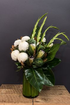 Using a mix of Disbuds, Protea, Kale and Gladioli, this design is a statement piece that's perfect for a corporate function or office. Enquire about flowers for your next event at www.flowermarket.com.au/corporate-events