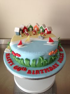 A delightful birthday cake, complete with seaside scene and beach huts.
