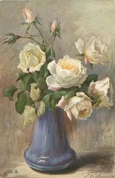 white roses & buds in a blue vase