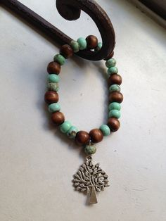 Green Turquoise and wood beads bracelet on Etsy, $14.99