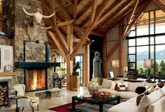 Matt and Clare Tiffin love the way the timber frame's braces mimic tree branches in the great room. Matt selected rock and stone from Colorado, Arkansas and Oklahoma to complement the post and beam home's natural interior. Timber Frame Homes, Timber House, Timber Frames, Stone Fireplace Designs, Fireplace Stone, Log Home Living, Living Rooms, Natural Stone Fireplaces, Ranch Style Homes