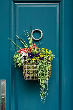 What You'll Need - How to Make a Basket Wreath - Southernliving. Wire basket Sheet moss Empty plastic water bottles Soil Spring flowers Green foliage  Love the door? Bermuda Turquoise (728) by Benjamin Moore is less formal than cobalt and not as beachy as most turquoises. Paired with a white or cream house, this deep color in a high gloss will stand out.