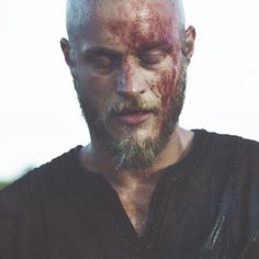 Travis Fimmel screen cap from Vikings. Just seconds from falling off cliff into the water below, season 1.