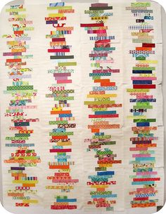 Love these strip type quilts.  reminds me of books!