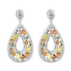 Color Splash  18K White Gold Earrings  Gold: 16.10 gms Diamonds: 5.67 cts Sapphire:  6.63 cts