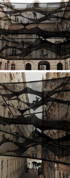 Numen-precident-Black Installation between buildings