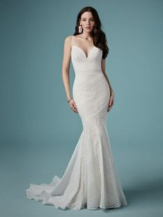 Maggie Sottero LILANA, Allover lace in a geometric pattern make up this simple boho fit-and-flare wedding dress. Complete with a deep sweetheart neckline and lace spaghetti straps. Finished with a zipper closure. Available in plus size. Fit And Flare Wedding Dress, Boho Wedding Dress, Wedding Attire, Mermaid Wedding, Bridal Dresses, Wedding Gowns, Bridal Gown, Lace Wedding, Wedding Dress Boutiques