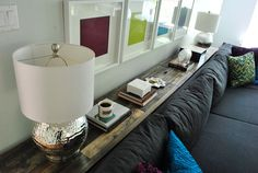 Young House Love | Console Table Behind A Couch- side storage shelves, secret compartment... Awesome.