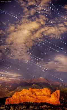 Meteor shower over Pikes Peak, Colorado I know it isn't a sun or moon.but it is an incredible photo and I live 50 miles from Pikes Peak. Have never seen a photo like this before.