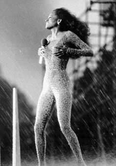 """A torrential downpour, with winds gusting up to 55 miles per hour, pelt pop singer Diana Ross during a free outdoor concert in Central Park, her """"gift to New York. Central Park, Selena Gomez, Diana Ross Supremes, Lady Sings The Blues, Splendour In The Grass, Vintage Black Glamour, Singing In The Rain, Pop Singers, Motown"""