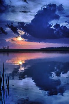 Deep blues and sunset reflections