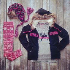 The perfect outfit to take you through all 4 seasons!  The Girls With Guns Clothing Burnout Tank in Charcoal, Earflap Bomber Beanie in Black & Pink, Jumping Buck Leggings, and Black Fur Hoodie is the perfect outfit for any country girl!