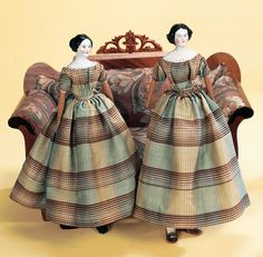 """Sister Dolls 19"""" Germany,circa 1860,the dolls were featured in Faurholt's Book of Dolls and Dollhouses with the note,""""Twins except for their china head,these well-bred young ladies from Zealand belonged to two sisters born in 1844 and 1847"""". Each is wearing its matching original wool plaid hand-stitched gown with exquisitely detailed handmade undergarments."""