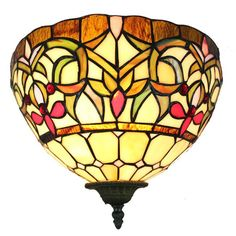 Bathe in the warm glow of this intricately designed Tiffany-style wall lamp. It's made up of a bronze fixture which gives it its traditional look, and 167 pieces of colored glass that come together to show off its elegant, artistic style.