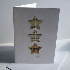 handmade Christmas card ... Franse Lelie: DIY-kerstkaarten ... upcycled paper die cut into stars ... machine sewn down in a row ... clean and simple ..