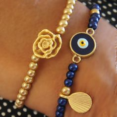 Evil eye bracelet, Rose pendant bracelet..... Evil Eye bead gives happiness to the friends and the beloved ones, protecting from the evil eyes.  Jewelry with these charms will represent your wishes as a New Year Gift.
