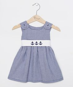 c61b348d131 Three sweet anchor appliqués hold down the bodice of this sweet jumper with  a gathered skirt