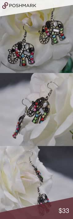 "Black & White Gem Elephant Animal Shaped Earrings Antique Silver Black & White Gem Elephant Cute Animal Shaped Earrings are perfect for any elephant lover.  Earrings that have been embellished with faux black and white and mixed color gemstones.   - 1 7/8"" drop from top of ear wire - Includes rubber stoppers - Ships in gift box  smoke free pet friendly home  Internal SKU: BWELEPHANT  Black & White Gem Elephant Earrings Animal Jewelry can add whimsy to any outfit, so snag yours today. Jennies…"