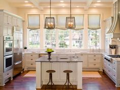 Not always a fan of white cabinets, but I'm loving this kitchen! Love all of the natural light!