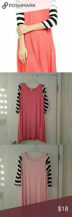 Women's spring dresses Very comfy spring dress, very soft and is 95% polyester and 5% spandex, so it does stretch.This is made to fit loose and Looks great with leggins. Available in Coral or Pink Sizes S, M & L  ** coral is only available in Small and Medium.** Dresses Asymmetrical