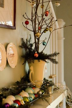 Vase with some evergreen boughs and barren sticks with or. Vase with some evergreen boughs and barren sticks with or… Simple Christm Christmas Mantels, Country Christmas, All Things Christmas, Simple Christmas, Winter Christmas, Vintage Christmas, Christmas Crafts, Christmas Ornaments, Frugal Christmas
