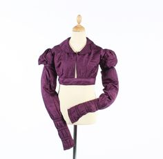 An 1800-10 dark purple damask silk spencer