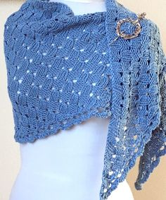Free Knitting Pattern for Imposter's Shawl - With its clever stitches, the Imposter's Shawl mimics woven and crochet work, but it is truly knitted from start to finish including the scalloped edge. Designed by Fancy Tiger Crafts. Pictured project by knitwit50.