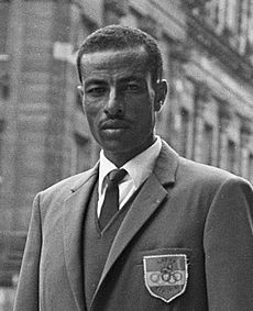 Abebe Bikila Abebe Bikila – was a double Olympic marathon champion from Ethiopia, most famous for winning a marathon gold medal in the 1960 Summer Olympics while running barefoot. Haile Selassie, History Channel, Oromo People, Olympic Runners, Human Fossils, Olympic Marathon, The Little Match Girl, All About Africa, Olympic Gold Medals