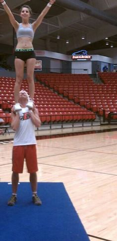 First toss to hands. Male Cheerleader stunting.