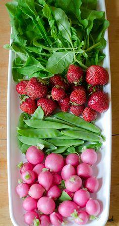 Ingredients for arugula, strawberry, snow pea and radish salad.